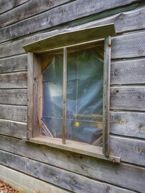 New house construction in secluded rural area abandoned several years ago builder left his measuring tape hanging from the window frame