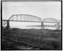 New steel bridge railroad at Glasgow Missouri  is a four-span through truss bridge over the Missouri River belonging to the Kansas City Southern railroad originally built in - and described as the worlds first all-steel bridge