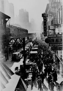 New York Citys Sixth Avenue elevated railway and the crowded street below ca