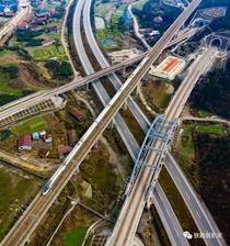Newly build tunnels roads and railroads criss-crossing old vilages in Huaihua China
