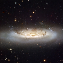 NGC  - a spectacular spiral galaxy that is currently being stripped of its gas content