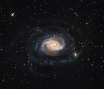 NGC  - a spiral galaxy much larger than our own and about  million light years away