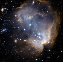 NGC  and Beyond It is only  million years old with massive young stars eroding the dusty material and triggering a progression of star formation