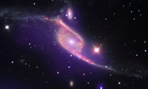 NGC  Galaxy Collision Switches on Black Hole