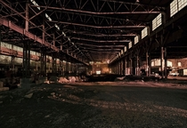 Night shot of an old granite mill in Bloomington Indiana I used available light which caused the orange glow  OC  x