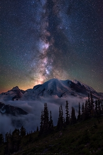 Night sky above Mt Rainier on a foggy night