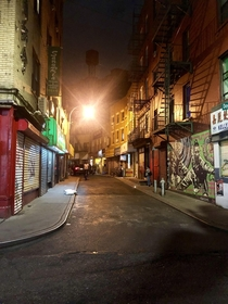 Nighttime view of old windy street in NYC Chinatown