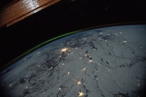 Nighttime view of the Earths limb with an aurora  January  A portion of the International Space Stations solar arrays caps this nighttime view of the Earths limb with an aurora as the orbital complex orbited  miles above Ukraine and Russia writes NASA