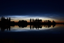 Noctilucent Clouds Reflections and Silhouettes by Peter Simmering