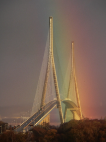 Normandy Bridge in France with a rainbow