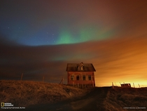 Northern Lights illuminate an abandoned farmhouse Reykjanes peninsula Iceland Photo by Fred Schalk