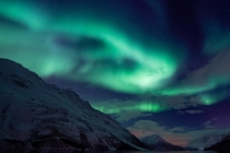 Northern Lights lighting up the sky outside of Troms Norway