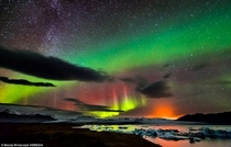 Northern Lights Milky Way and an ERUPTING VOLCANO in one photo Iceland by Maciej Winiarczyk