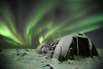 Northern lights over an abandoned Icelandic farm
