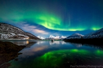 Northern Lights over the Fjords near Tromso Norway
