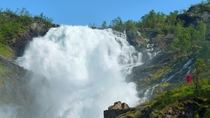 Norways Kjosfossen waterfall and the dancing lady is red