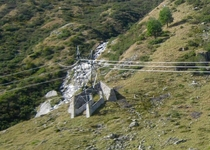 Not sexy but interesting stone walls to protect transmission towers from alpine avalanches Lukmanierpass Switzerland