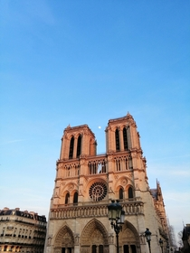Notre-Dame de Paris France with the moon showing off