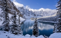 Now this is what I call EarthPorn Moraine Lake in the middle of winter Absolutely stunning