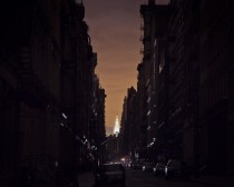 NYC during Hurricane Sandy - the Chrysler Building lit up from a darkened Soho