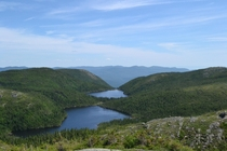 OC I went hiking in a National park in Malbaie and found this two lakes between the mountains QubecCanada