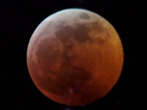 OC The Blood Moon during full eclipse via my smartphone looking through a digiscope southeastern US