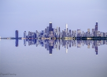 Oh the Reflections - Chicago reflecting on a calm and silent Lake Michigan  by Piyush Pandey x-post rUnitedStatesofAmerica
