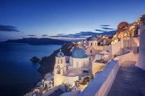 Oia in Santorini at Dusk  Photographed by Allard Schager