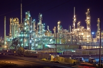 Oil refinery at night near Denver