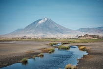 Ol Doinyo Lengai the Mountain of God from the south shore of Lake Natron