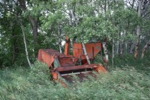 Old abandoned combine reclaimed by nature in my dads pasture