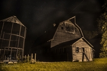 Old abandoned farm on a starry night in Iowa