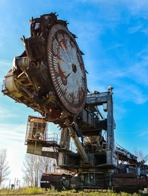 Old and giant excavator in an abandoned quary France