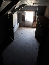 Old attic room in a mansion from the s its not completely abandoned there still lives an old lady on the ground floor