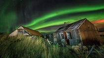 Old boat houses in Iceland under Northern Lights