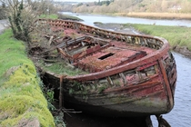 Old boat on tidal river near Innishannon Co Cork Ireland x