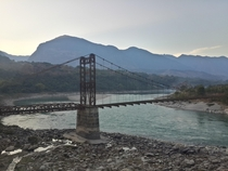 Old Burma Road Bridge over the Salween River in Yunnan Province China  This bridge and the Burma Road it was a part of were built by the US Army during World War Two in order to open up a supply route to China from India