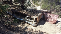 Old car found along hiking trail thats below a road