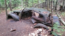 Old car in the forest Killarney Provincial Park Ontario Canada