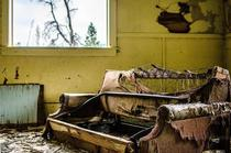 Old couch in an abandoned Montana mining town