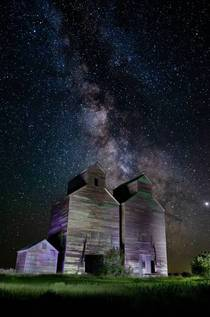 Old grain elevator and milky way