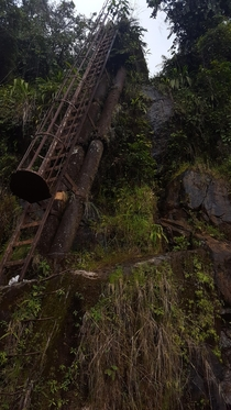 Old ladder leading up to a dam