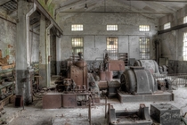 old machinery in a defunct plant by scruffybread