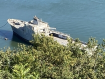 Old military ship left to decay in a ship graveyard in the west of France