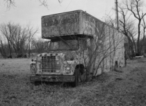 Old North American truck sits decaying in a field in Iowa shot with Fuji GSs Kodak Tmax