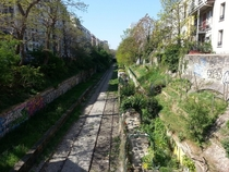 Old Railway inside Paris with gardens along side