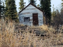 Old RCMP cabin km west of Inuvik NT Canada ft by ft  bunk with  gallon fuel drum for fireplace