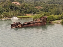 Old rusty cargo ship in Roatan Honduras oc