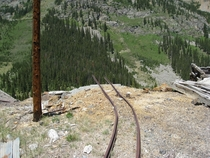 Old tracks leading out of a mine in Montezuma CO