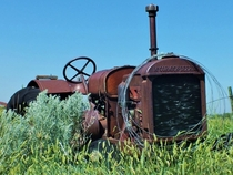 Old tractor abandoned near Nashua MT OC-- x